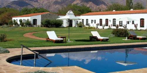 View of the garden, pool and mountains